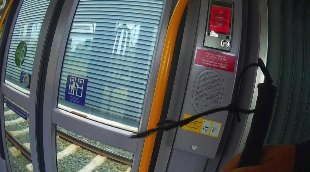 Photo of Luas internal door open button located within the interior door frame